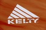 Kelty logo on Foxhole 3 tent pops with illumination when headlamp beam hits it at night. There's a big Kelty logo on both sides of the tent.
