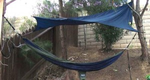 Eagles Nest two-person hammock with rainfly and its semi-permanent location in the back yard.