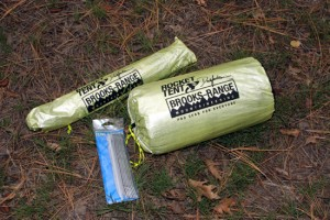 Shown are the A2 tent in its small stuff sack, alumimum poles and aluminum stakes in their own sack.