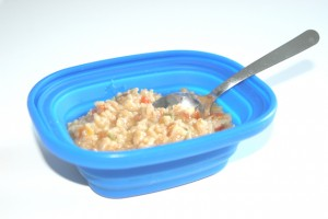 The lid converts into a bowl that can easily hold a hot meal.