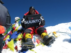 Apa Sherpa on summit of Mt. Everest whipping out the Suunto banner. Photo: Apa Sherpa Foundation.