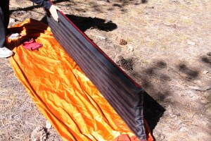 Big Agnes Air Core pad seen in relation to a Marmot Home Alone Bivy tent. It fit fine.