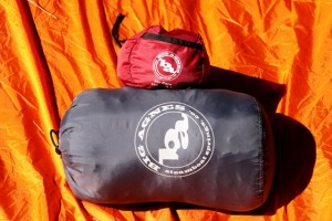 Big Agnes (BA) Air Core in stuff sack and BA Yampa sleeping bag show compact relationship. Both fit into Osprey Xenon lower sleeping bag compartment with room to spare.