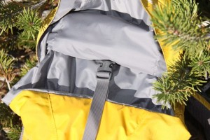A centered compression strap cinches down on main pack compartment to secure gear from top to bottom of the pack.