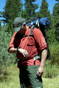 Keep wrist horizontal for accurate compass readings. Backpack is Lowe-Alpine FTX Cerro Torre 65:85.