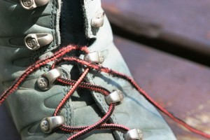 Boot laces frayed at the fourth eyelet up from toe.