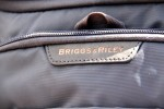 Briggs & Riley logo on leather tab atop front pocket.