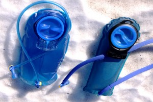 Three-liter Antidote reservoir on left compared to two-liter standard reservoir on right.