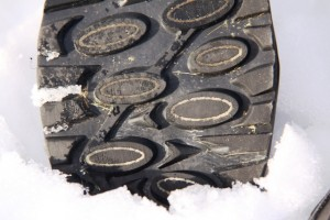 Texturized fabric loops on large oval lugs work with rubber compounds and tread pattern to improve traction on ice.