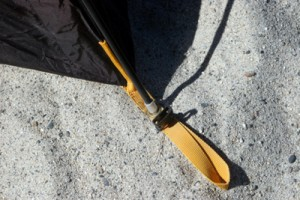 The poles slip into the foot lanyards of the tent which also have clasps for attaching and securing the rainfly.
