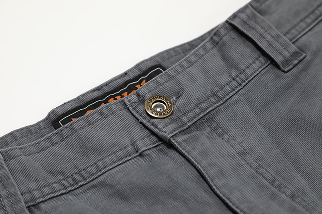 The waist band features a rivited center button